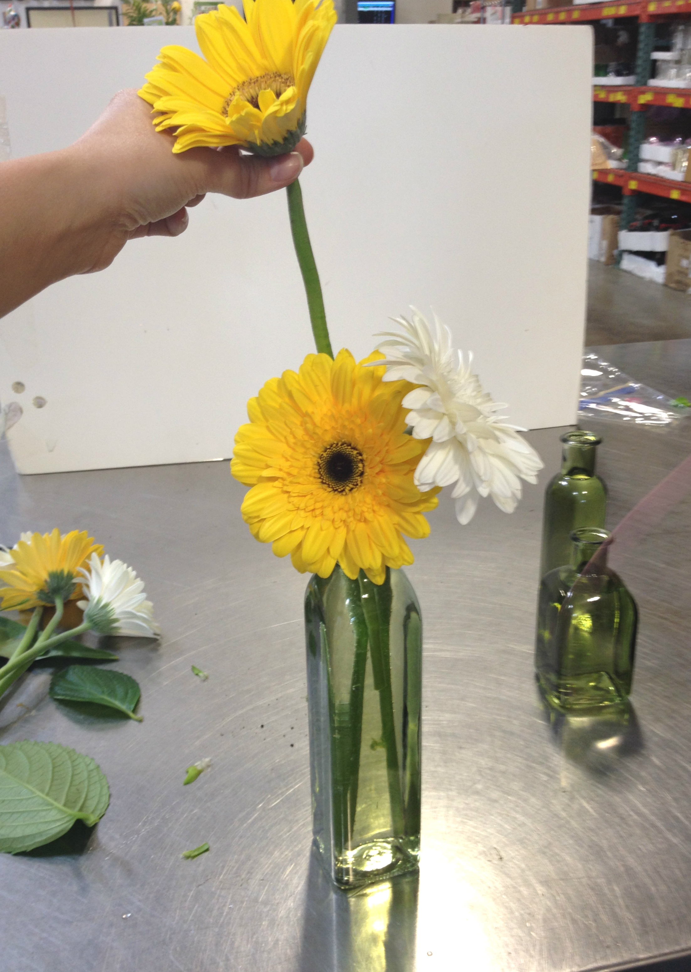 how to make a gerbera bud vase arrangement